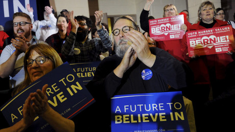 Supporters of US Democratic presidential candidate Bernie Sanders cheer as he speaks at a town hall campaign event in Clinton, Iowa on January 23, 2016. © Mark Kauzlarich