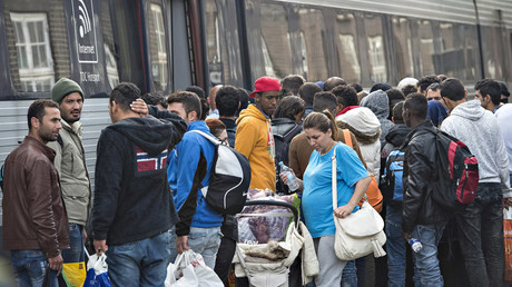 Denmark approves confiscation of refugees' valuables, delay of family reunifications