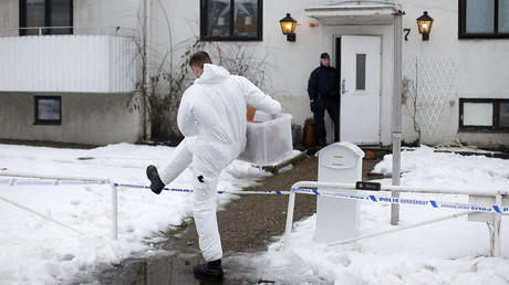 Police investigators are seen outside a home for juvenile asylum seekers in Molndal in south western Sweden on January 25, 2016. © Adam Ihse / TT News Agency