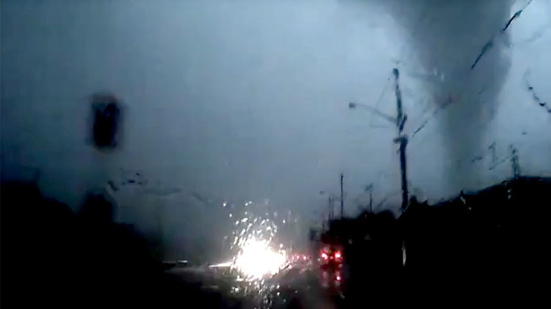 'Did not see that coming': Driver careers inches from tornado, claims not to have noticed it (VIDEO)