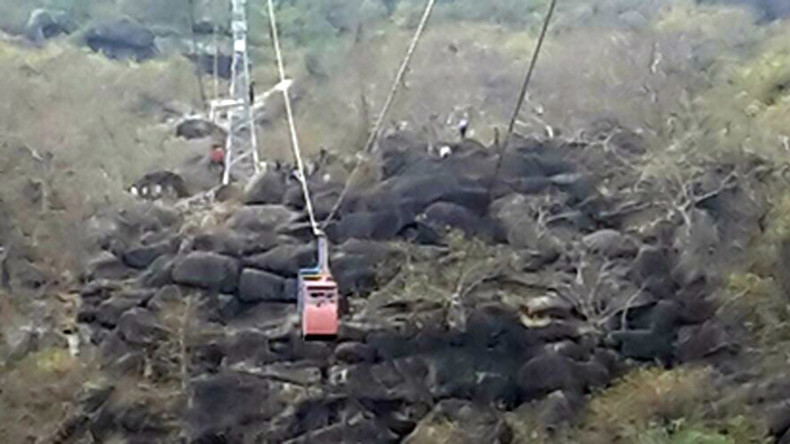 Cable car falls, injuring & trapping tourists near hilltop Indian temple