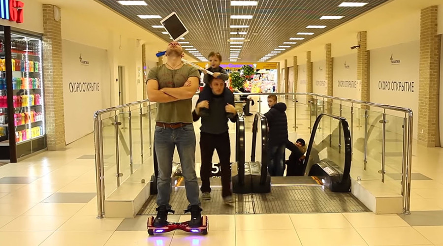 Boy takes out iPad off hoverboarding circus performer's head (VIDEO)