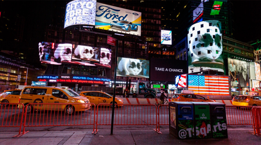 'Famous video' of cat licking milk takes over Times Square...for 3 minutes