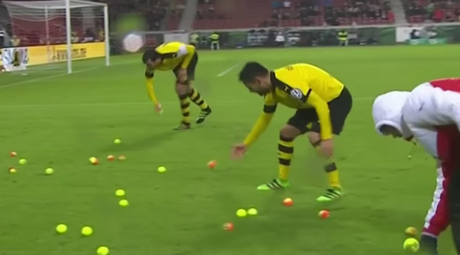 Borussia Dortmund fans hurl tennis balls onto pitch in ticket price protest (VIDEO)
