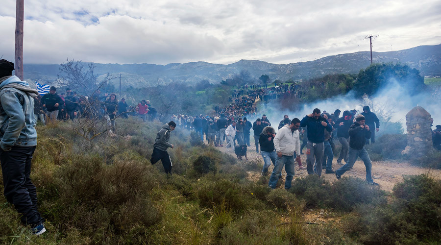 Greek police fire tear gas at rally protesting construction of refugee center on tourist island
