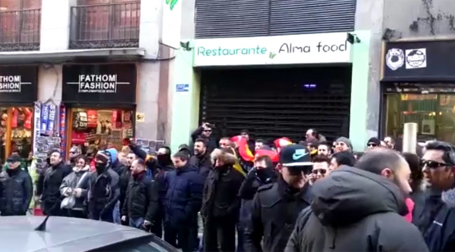 Two Madrid security chiefs hide from angry protesters who chase them into bar (VIDEO)