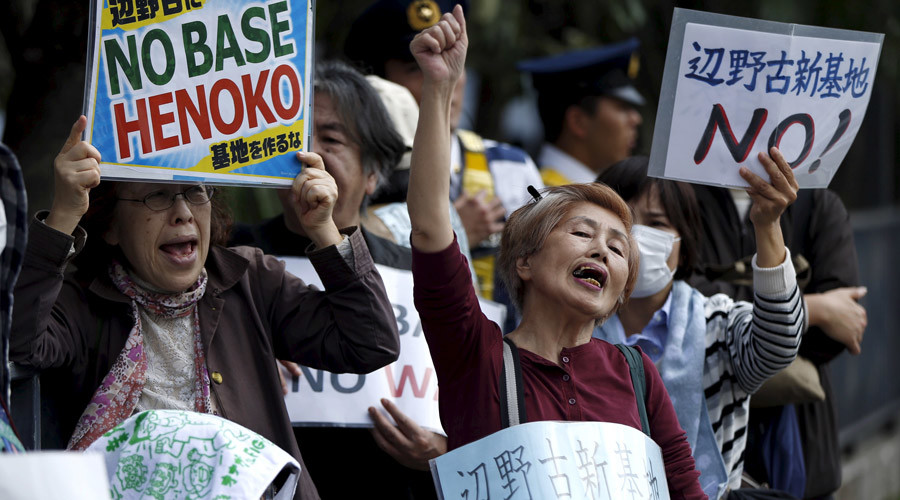 Up to 30,000 flock to Japan parliament to protest US base relocation in Okinawa