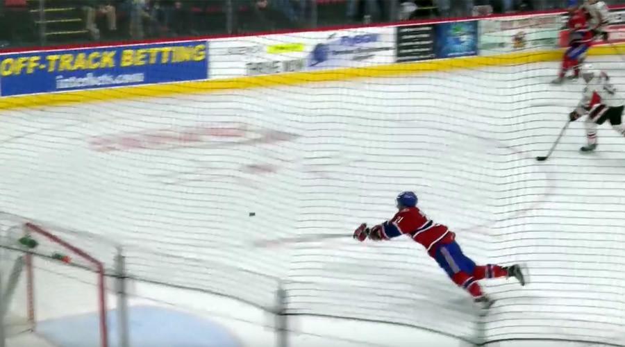 AHL hockey star makes amazing open net sliding save (VIDEO)