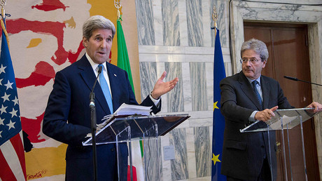 U.S. Secretary of State John Kerry (L) speaks next to Italian Foreign Minister Paolo Gentiloni during a news conference following a ministerial meeting of the so-called