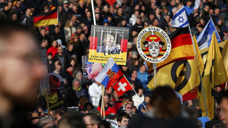Supporters of the anti-Islam movement Patriotic Europeans Against the Islamisation of the West (PEGIDA) hold posters depicting German Chancellor Angela Merkel during a demonstration in Dresden, Germany, February 6, 2016. © Hannibal Hanschke
