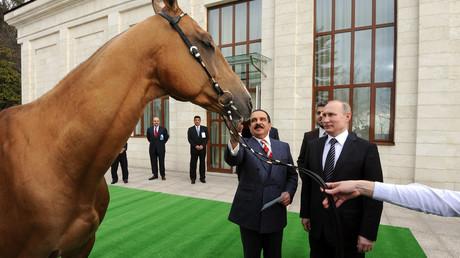 Presents from Putin: Merkel recalls receiving 'very good smoked fish' from Russian president