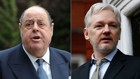 Sir Nicholas Soames MP (L) and WikiLeaks founder Julian Assange. © Reuters