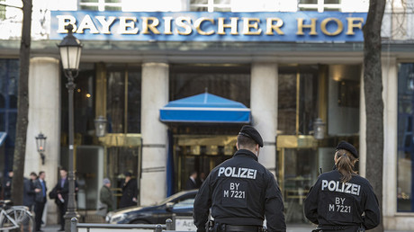Policemen walk in front of the Bayerischer Hof hotel, the location for the 52nd Munich Security Conference (MSC), in Munich, southern Germany, on February 11, 2016. ©Thomas Kienzle