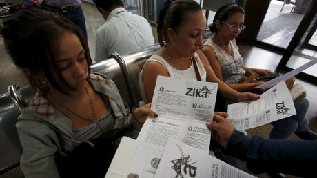 Colombian women listen as a health worker distributes information how to prevent the spread of the Zika virus, at the transport terminal in Bogota, Colombia © John Vizcaino