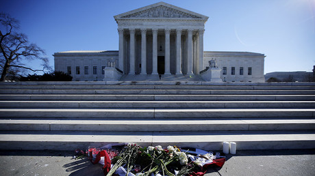 Flowers are seen in front of the Supreme Court building in Washington D.C. after the death of U.S. Supreme Court Justice Antonin Scalia, February 14, 2016. © Carlos Barria