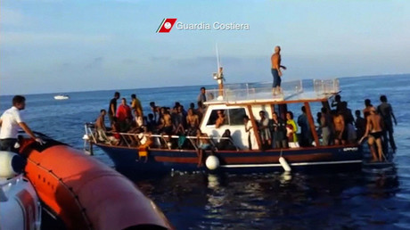 A still image taken from video released on October 4, 2013 by the Italian Coastguard shows migrants rescued from the water off the southern Italian island of Lampedusa on Thursday October 3, 2013. © Italian Coast Guard