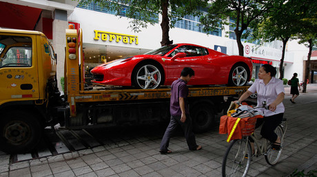 A Ferrari  loaded onto a truck after being bought at showroom in Shenzhen © Bobby Yip