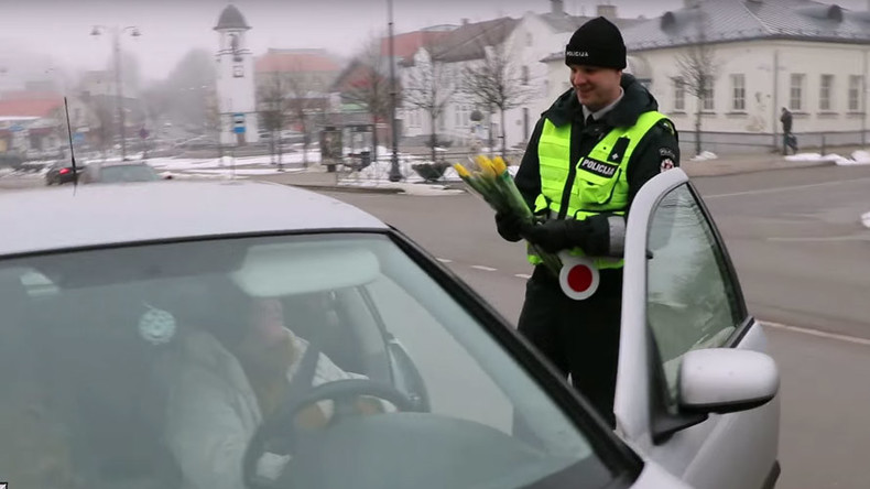 Russian & Lithuanian police offer flowers to female motorists for International Women's Day