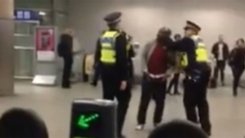 'I'm not a criminal!' Police beat man with baton at London's St. Pancras Station (VIDEO)