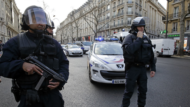 Counter-terror police detain armed 'madman' after siege in Paris suburb