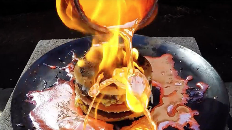 Molten copper struggles to break down Big Mac, stunning the internet (VIDEO)