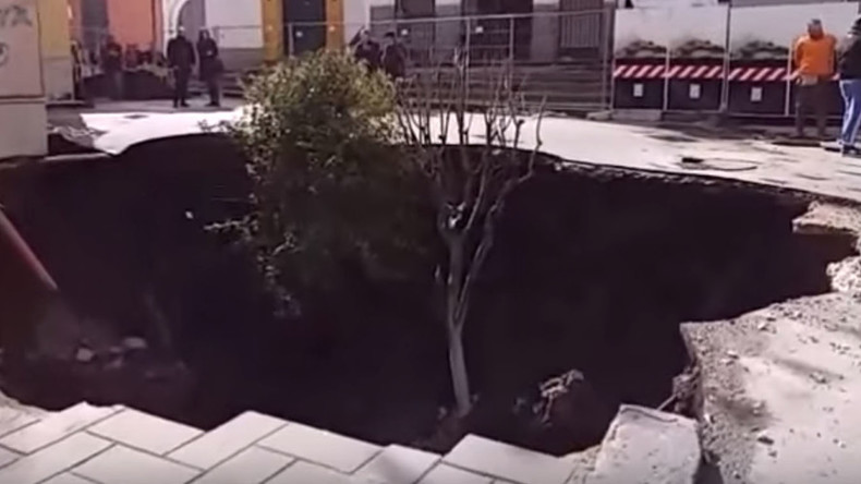 Car & trees swallowed up in yet another Italian sinkhole (VIDEO)