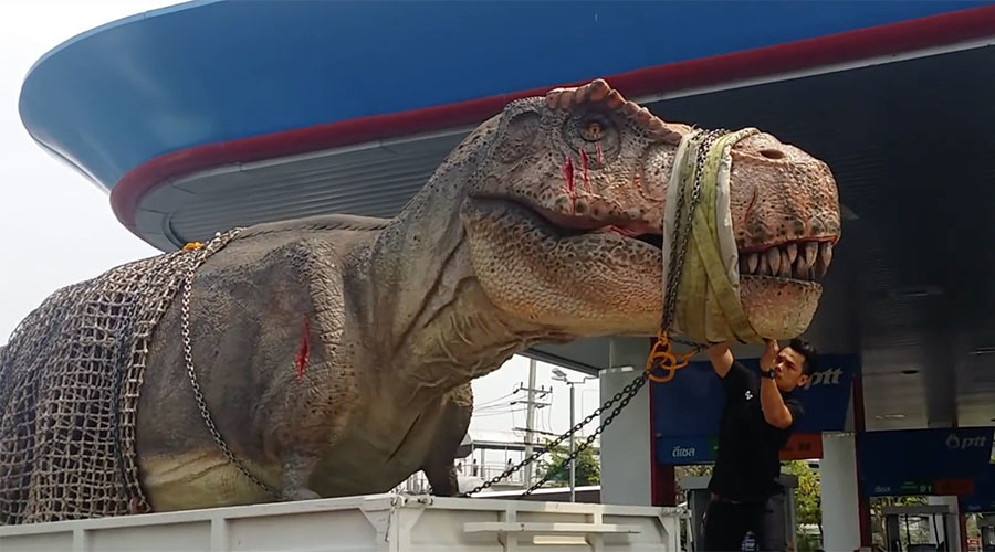 Jurassic Parked: T rex stuck in rush hour traffic (VIDEO & PHOTOS)