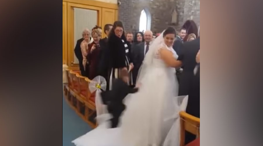 Ninja kid attacks wedding dress while bride walks down the aisle (VIDEO)
