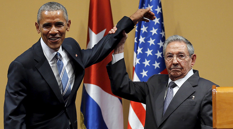 Awkward! Obama left hanging after Castro deflects embrace (VIDEO)