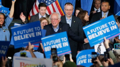 U.S. Democratic presidential candidate and U.S. Senator Bernie Sanders arrives with his wife Jane (L) and son Levi (rear) at his Super Tuesday rally in Burlington, Vermont March 1, 2016. © Brian Snyder
