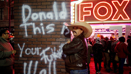 Hundreds of protesters rally outside Republican debate in Detroit