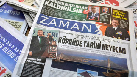 1st edition of Turkish Zaman daily after govt takeover sees smiling Erdogan on front page