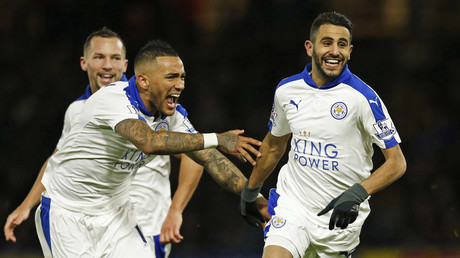 Riyad Mahrez celebrates with team mates after scoring the first goal for Leicester © Eddie Keogh
