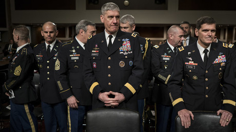 Army General David Rodriguez (C), commander of the US Africa Command, and Army General Joseph Votel (R), commander of the US Special Operations Command, wait with others for a hearing of the Senate Armed Services Committee on March 8, 2016 in Washington, DC. © Brendan Smialowski