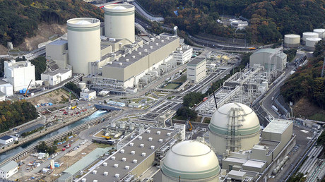 An aerial view shows No. 4 (front L), No. 3 (front R), No. 2 (rear L) and No. 1 reactor buildings at Kansai Electric Power Co.'s Takahama nuclear power plant in Takahama town, Fukui prefecture. © Kyodo