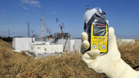 A radiation monitor indicates 131.00 microsieverts per hour near the No.4 and No.3 buildings at the Fukushima nuclear power plant. © Kimimasa Mayama