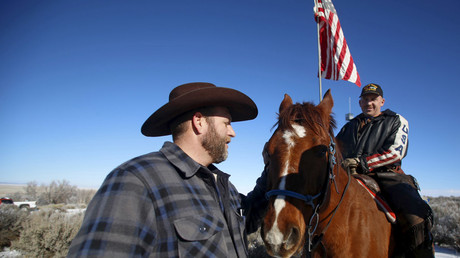 Ldeader of a group of armed protesters Ammon Bundy (L) greets occupier Duane Ehmer and his horse Hellboy at the Malheur National Wildlife Refuge near Burns, Oregon, January 8, 2016. © Jim Urquhart