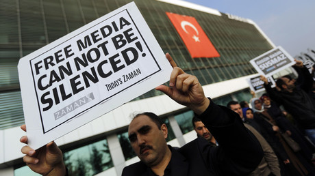 Zaman media group employees hold banners outside the headquarters of Zaman daily newspaper in Istanbul. © Murad Sezer