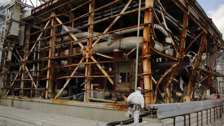 A worker near the No. 3 reactor building at the tsunami-crippled Fukushima Daiichi nuclear power plant in Japan. © Toru Hanai