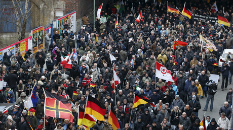 Far right-wing supporters march during rally against the German government's immigration policies and migrants, near-by the Chancellery in Berlin, Germany, March 12, 2016. © Fabrizio Bensch