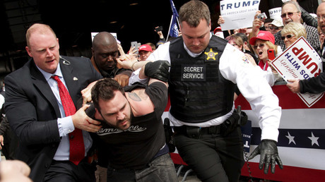 U.S. Secret Service agents detain a man after a disturbance as U.S. Republican presidential candidate Donald Trump spoke at Dayton International Airport in Dayton, Ohio March 12, 2016. © William Philpott