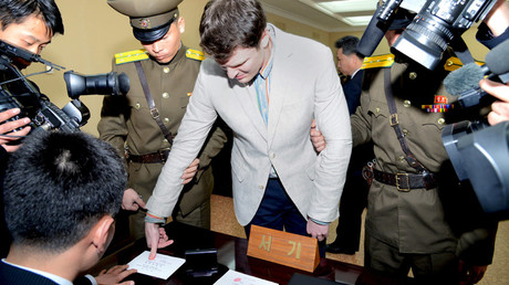 U.S. student Otto Warmbier has his fingerprints taken at North Korea's top court, in this photo released by North Korea's Korean Central News Agency (KCNA) in Pyongyang on March 16, 2016. © KCNA