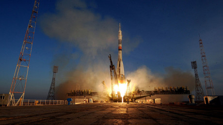 Soyuz docks with Intl Space Station, sends 3 new crewmembers aboard