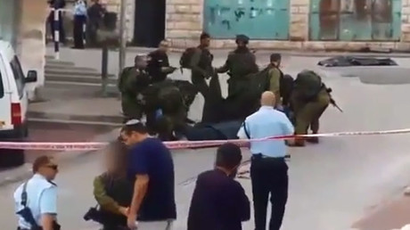 Video shows Israeli soldier greeting far-right activist after killing wounded Palestinian stabber