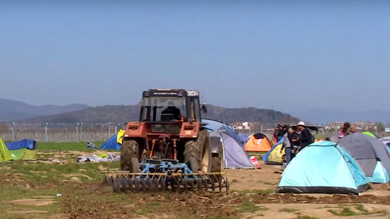 Outraged Greek farmer plows tractor through refugee camp (VIDEO)
