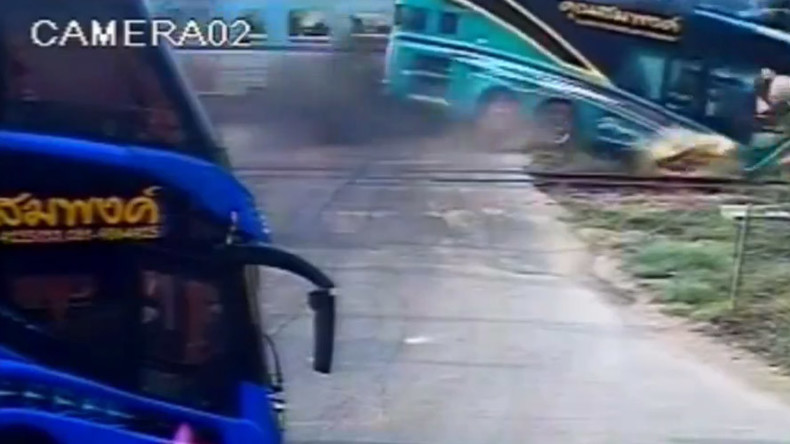 Train crashes into tourist bus in Thailand, killing 3 (VIDEO)