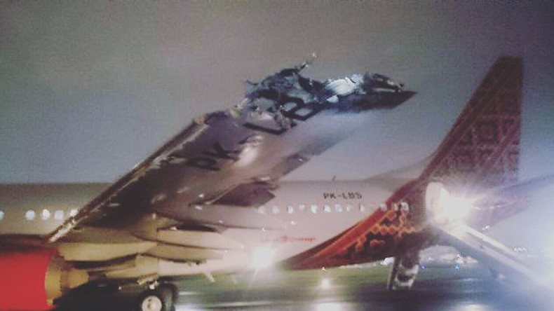 Wing & tail ripped off as 2 planes collide on takeoff in Indonesia (PHOTOS, VIDEO)