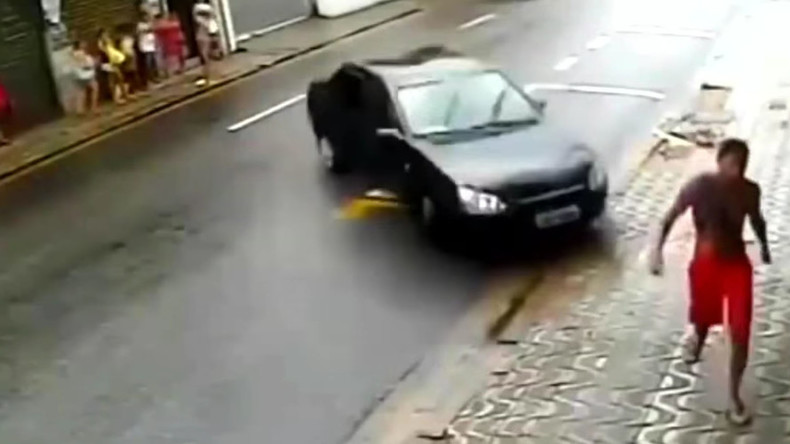 Incredible near-death experience as unwitting pedestrian avoids runaway car (VIDEO)