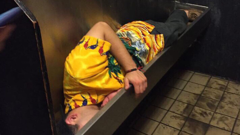 Taking the piss: Drunk student falls asleep in urinal (PHOTO)