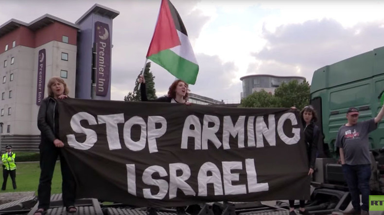 'Arrest arms dealers, not peace campaigners!' 8 on trial over weapons fair protest